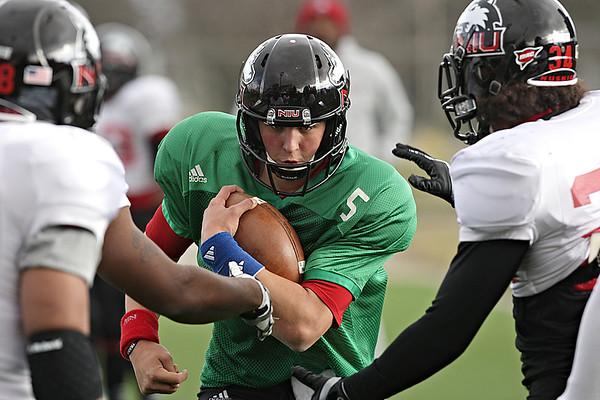 Northern Illinois quarterback Matt Williams participates in a drill during practice at Huskie Stadium in DeKalb, Ill., Saturday, Dec. 8, 2012. (Rob Winner photo)