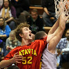 Batavia's Luke Horton battles for a rebound during Saturday's game at Larkin. (Jeff Krage photo for the Kane County Chronicle)