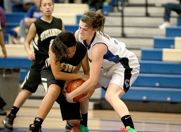 Geneva's Sami Pawlak (right) and Streamwood's Kiana Jeremiah fight over a jump ball during their game at Geneva Wednesday night.(Sandy Bressner photo)