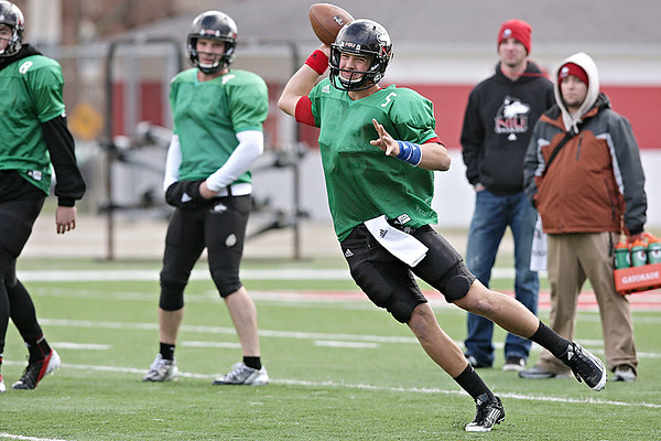 Northern Illinois quarterback Matt Williams looks to pass during practice at Huskie Stadium in DeKalb, Ill., Saturday, Dec. 8, 2012.(Rob Winner photo)