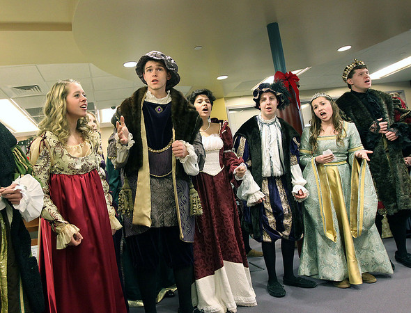 The Kaneland High School Madrigal singers perform Friday at the Town & Country Library.<br /> (Jeff Krage photo for the Kane County Chronicle)