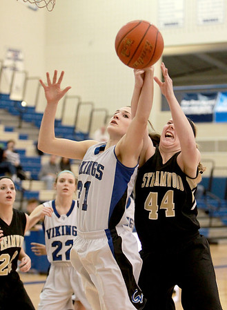 Geneva's Sami Pawlak (left) battles Streamwood's Hannah McGlone for a rebound during their game at Geneva Wednesday night.(Sandy Bressner photo)