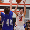 St. Charles East's Jake Asquini goes up for a shot during their game against Geneva Friday night. (John Cox photo)