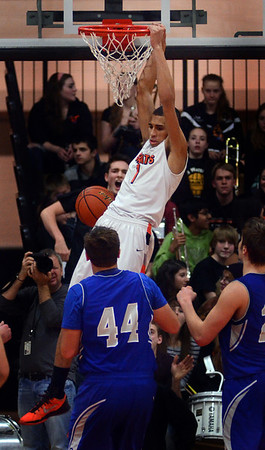 St. Charles East's AJ Washington slams home one of two second-half dunks during their game against Geneva Friday night.  (John Cox photo)