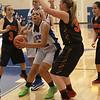 Geneva's Sidney Santos looks to the basket as Erin Bayram of Batavia is defending.<br /> Staff photo by Sarah Minor(Sarah Minor photo)