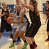 Geneva's Sidney Santos looks to the basket as Erin Bayram of Batavia is defending.<br /> Staff photo by Sarah Minor(Sarah Minor photo)