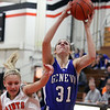 Geneva's Sami Pawlak shoots over St. Charles East's Katie Claussner during Thursday's game at St. Charles East.<br /> (Jeff Krage photo for the Kane County Chronicle)
