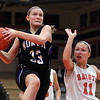 St. Charles North's Nicole Davidson goes up for a shot after beating St. Charles East's Carly Pottle to the basket during Saturday's game at St. Charles East High School.<br /> (Jeff Krage photo for the Kane County Chronicle)
