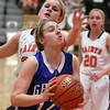 Geneva's Ellen Dwyer draws a foul on St. Charles East's Hannah Nowling on her to the basket during Thursday's game at St. Charles East.<br /> (Jeff Krage photo for the Kane County Chronicle)