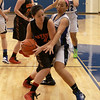 Sami Villarreal of Batavia is trying to get the ball out of Batavia's end but is being blocked by Kelly Gordon of Geneva.<br /> Staff photo by Sarah Minor(Sarah Minor photo)
