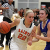St. Charles East's Anna Bartels is closely defended by Geneva's Sami Pawlak during Thursday's game at St. Charles East.<br /> (Jeff Krage photo for the Kane County Chronicle)