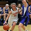 St. Charles East's Carly Pottie drives around Geneva's Ellen Dwyer during Thursday's game at St. Charles East.<br /> (Jeff Krage photo for the Kane County Chronicle)