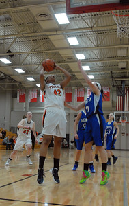 Wheaton Warrenville South senior Diamond Thompson (42) goes up for a shot during a semi-final game against Geneva in the Naperville North/Benet Academy Girls Basketball Holiday Tournament at Benet Academy in Lisle on Thursday, Dec. 20, 2012. Matthew Piechalak — mpiechalak@shawmedia.com.