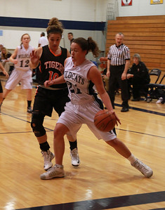 West Chicago's Laura Panicali dribbles along the baseline during their game against Wheaton Warrenville South. Staff photo by Sarah Minor