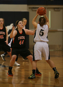 Olivia Linebarger defends against a West Chicago player during Wheaton Warrenville South's game on Saturday, Dec. 1. Staff photo by Sarah Minor