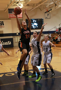 Maggie Dansdill of Wheaton Warrenville South goes up for a rebound during their game against West Chicago. Staff photo by Sarah Minor