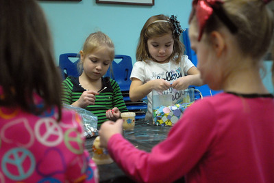 Denisa, left, and Autumn, both five-years-old, decorate jars of homemade lotion—a craft project for their mothers— during the Bloomingdale Park District's Winter Break Camp at the Johnston Recreation Center, 172 Circle Ave. in Bloomingdale on Thursday, Jan. 3, 2012. Matthew Piechalak — mpiechalak@shawmedia.com.