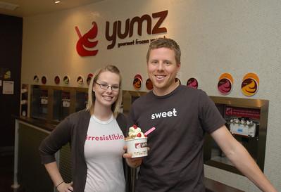 Regional manager Kevin Visel and manager of site development Lauren Visel stand by the yogurt machines at Yumz Gourmet Frozen Yogurt, 28341 Diehl Rd. in Warrenville on Friday, Dec. 7, 2012. Staff photo by Matthew Piechalak