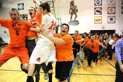 Daniel J. Murphy - dmurphy@shawmedia.com  McHenry guard Danny Glick celebrates a win over Crystal Lake South with the McHenry student section Thursday March 1, 2012 at Cary-Grove High School in Cary. McHenry defeated Crystal Lake South 51-44 for the IHSA Class 4A Regional title.