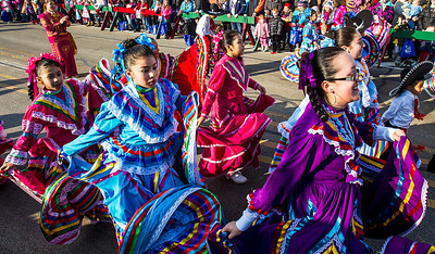 Kyle Grillot - kgrillot@shawmedia.com   Ballet Folklorico Girasol members advance down West Main Street during the Merry Cary Holiday Parade Sunday in Cary. Parade participants including local businesses, community groups and organizations gather along South Wulff Street and advance down West Main Street towards Downtown Cary.