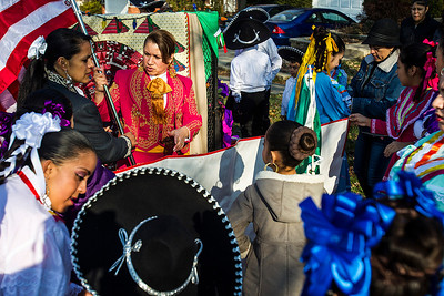 Kyle Grillot - kgrillot@shawmedia.com   Ballet Folklorico Girasol members prepare for the start of the Merry Cary Holiday Parade Sunday in Cary. Parade participants including local businesses, community groups and organizations gather along South Wulff Street and advance down West Main Street towards Downtown Cary.