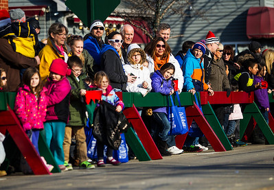Kyle Grillot - kgrillot@shawmedia.com   The crowd watches from the sidewalk during the Merry Cary Holiday Parade Sunday in Cary. Parade participants including local businesses, community groups and organizations gather along South Wulff Street and advance down West Main Street towards Downtown Cary.