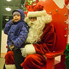 Jillian Bonnes, 4, from Batavia tells Santa what she would like for Christmas at The Batavia Celebration of Lights Festival on The Batavia River Walk in Batavia, IL on Sunday, December 01, 2013 (Sean King for Shaw Media)