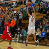 St. Charles East's Mick Vyzral (11) shoots a three pointer against St. Joseph's during the 55th Annual Ron Johnson Basketball Tournament in St.Charles East High School in St.Charles, IL on Friday, November 29, 2013 (Sean King for Shaw Media)