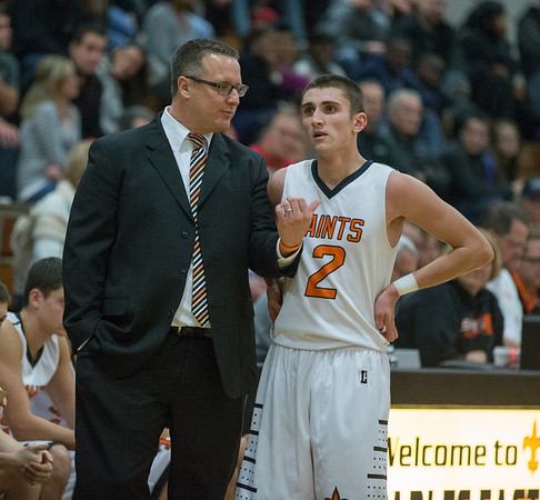 St. Charles East's Head Coach Patrick Woods gives instructions to Dom Adduci (2) during a stop in play against St. Joseph during the 55th Annual Ron Johnson Basketball Tournament in St.Charles East High School in St.Charles, IL on Friday, November 29, 2013 (Sean King for Shaw Media)