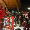 Batavia football coach Dennis Piron talks to the large crowd at The Batavia Celebration of Lights Festival on The Batavia River Walk in Batavia, IL on Sunday, December 01, 2013 (Sean King for Shaw Media)