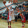 St. Charles East's Dom Adduci (2) drives to the basket against St. Joseph's during the 55th Annual Ron Johnson Basketball Tournament in St.Charles East High School in St.Charles, IL on Friday, November 29, 2013 (Sean King for Shaw Media)
