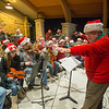 Batavia Community Band Director John Heath directs the band during The Batavia Celebration of Lights Festival on The Batavia River Walk in Batavia, IL on Sunday, December 01, 2013 (Sean King for Shaw Media)