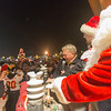 Batavia Mayor Schielke, Offensive lineman for the Batavia Bulldogs Jack Breshears and Santa Claus push the switch to light the Batavia Christmas Tree at The Batavia Celebration of Lights Festival on The Batavia River Walk in Batavia, IL on Sunday, December 01, 2013 (Sean King for Shaw Media)