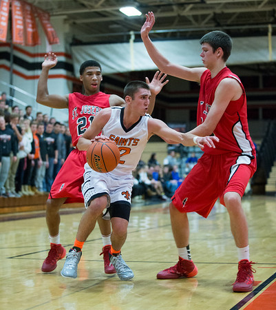 St. Charles East's Dom Adduci (2) drives baseline against St. Joseph's Joffery Brown (21) and Nick Rakocevic (35)<br /> during the 55th Annual Ron Johnson Basketball Tournament in St.Charles East High School in St.Charles, IL on Friday, November 29, 2013 (Sean King for Shaw Media)