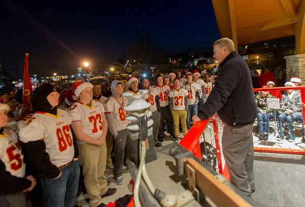 Batavia Mayor Jeff Schielke congratulates the Batavia High School Football Team for bringing home the 5A State Championship at The Batavia Celebration of Lights Festival on The Batavia River Walk in Batavia, IL on Sunday, December 01, 2013 (Sean King for Shaw Media)