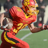 Erica Benson-ebenson@shawmedia.com<br /> Batavia's Blake Crowder fields the ball after receiving the kickoff during their state game against Richards in DeKalb Saturday November 16 2013. Batavia leads the game 28/7 in the half.