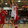 St. Charles East's Dom Adduci (2) drives the hoop against St. Joseph's Nick Rakocevic (35) during the 55th Annual Ron Johnson Basketball Tournament in St.Charles East High School in St.Charles, IL on Friday, November 29, 2013 (Sean King for Shaw Media)