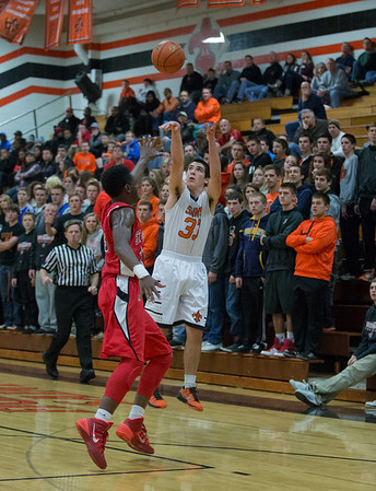 St. Charles East's Jake Asquini (33) shoots a three pointer over St. Joseph's Jordan Ash (23) during the 55th Annual Ron Johnson Basketball Tournament in St.Charles East High School in St.Charles, IL on Friday, November 29, 2013 (Sean King for Shaw Media)
