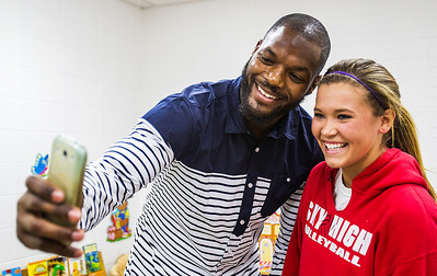 """Kyle Grillot - kgrillot@shawmedia.com   Martellus Bennett takes a """"selfie"""" with McKenna Miller, 15, of Crystal Lake during the autograph signing at Sage YMCA Tuesday in Crystal Lake. In order to get an autograph spectators bring an unwrapped new toy or non-persihable food item to benefit Toys for Tots and McHenry County food pantries."""