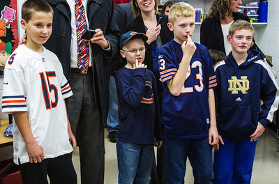 Kyle Grillot - kgrillot@shawmedia.com   Young fans watch as Martellus Bennett arrives during the autograph signing at Sage YMCA Tuesday in Crystal Lake. In order to get an autograph spectators bring an unwrapped new toy or non-persihable food item to benefit Toys for Tots and McHenry County food pantries.