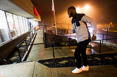 Kyle Grillot - kgrillot@shawmedia.com   Martellus Bennett enters the Sage YMCA before his autograph signing Tuesday in Crystal Lake. In order to get an autograph spectators bring an unwrapped new toy or non-persihable food item to benefit Toys for Tots and McHenry County food pantries.