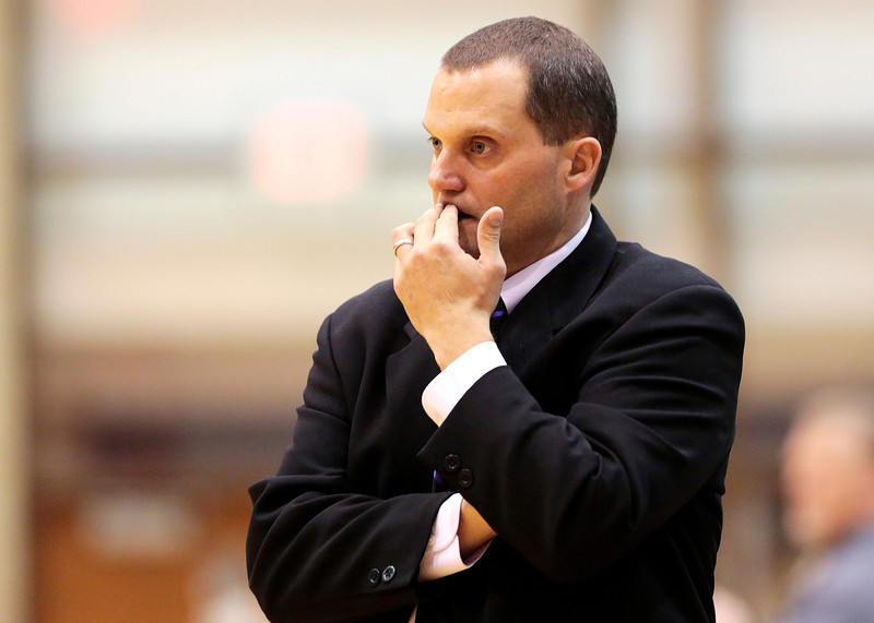 Kyle Grillot - kgrillot@shawmedia.com   Woodstock North head coach Steve Ryan watches his team during the third quarter of the high school basketball game between Woodstock North and Harvard Wednesday in Woodstock. Woodstock North won the game 61-48.