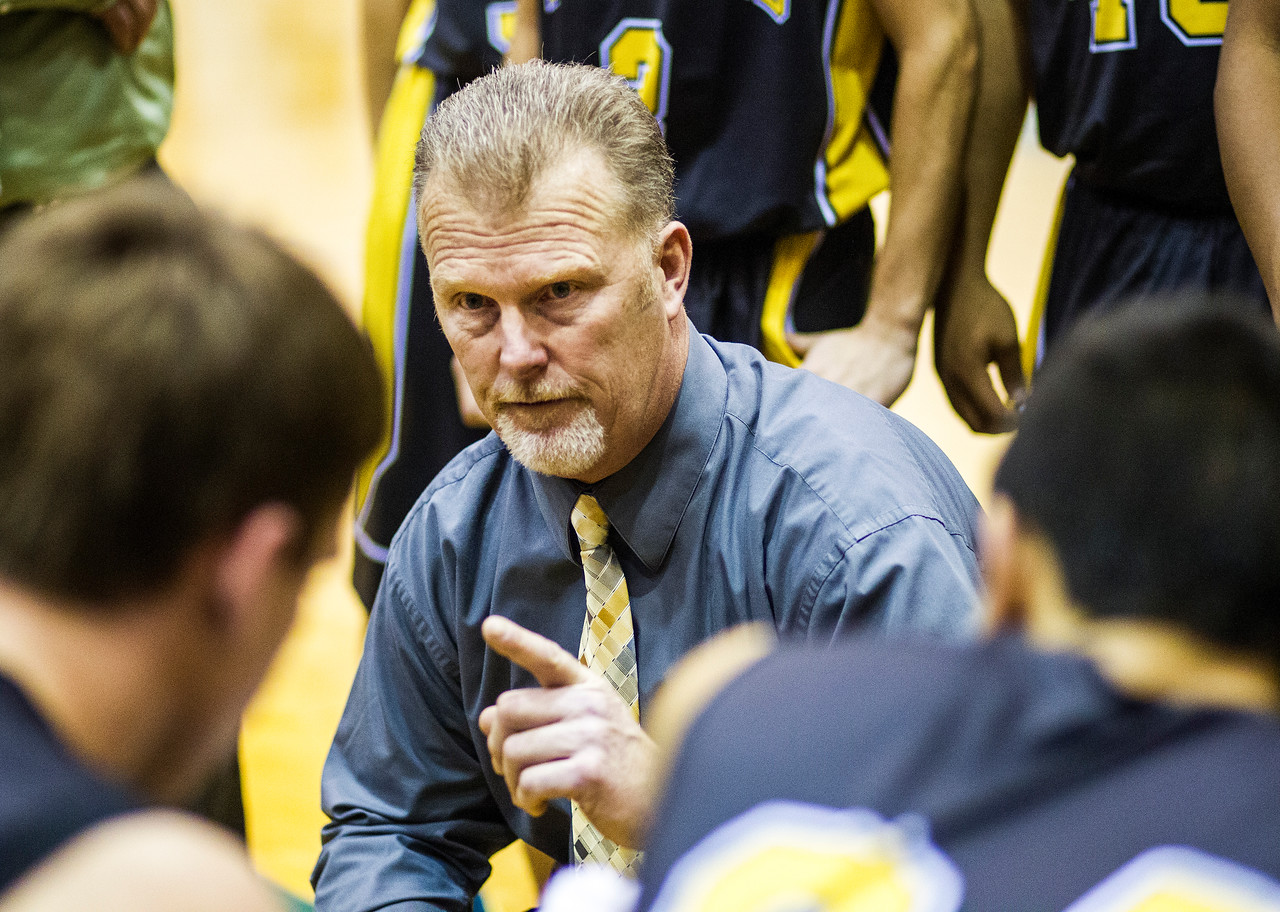 Kyle Grillot - kgrillot@shawmedia.com   Harvard head coach Donnie Nolen talks with his team while in a time out during the high school basketball game between Woodstock North and Harvard Wednesday in Woodstock. Woodstock North won the game 61-48.