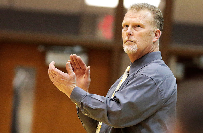 Kyle Grillot - kgrillot@shawmedia.com   Harvard head coach Donnie Nolen applauds his team during the high school basketball game between Woodstock North and Harvard Wednesday in Woodstock. Woodstock North won the game 61-48.