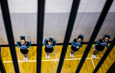 Kyle Grillot - kgrillot@shawmedia.com   The Woodstock North cheerleaders warm up before the start of the high school basketball game between Woodstock North and Harvard Wednesday in Woodstock. Woodstock North won the game 61-48.