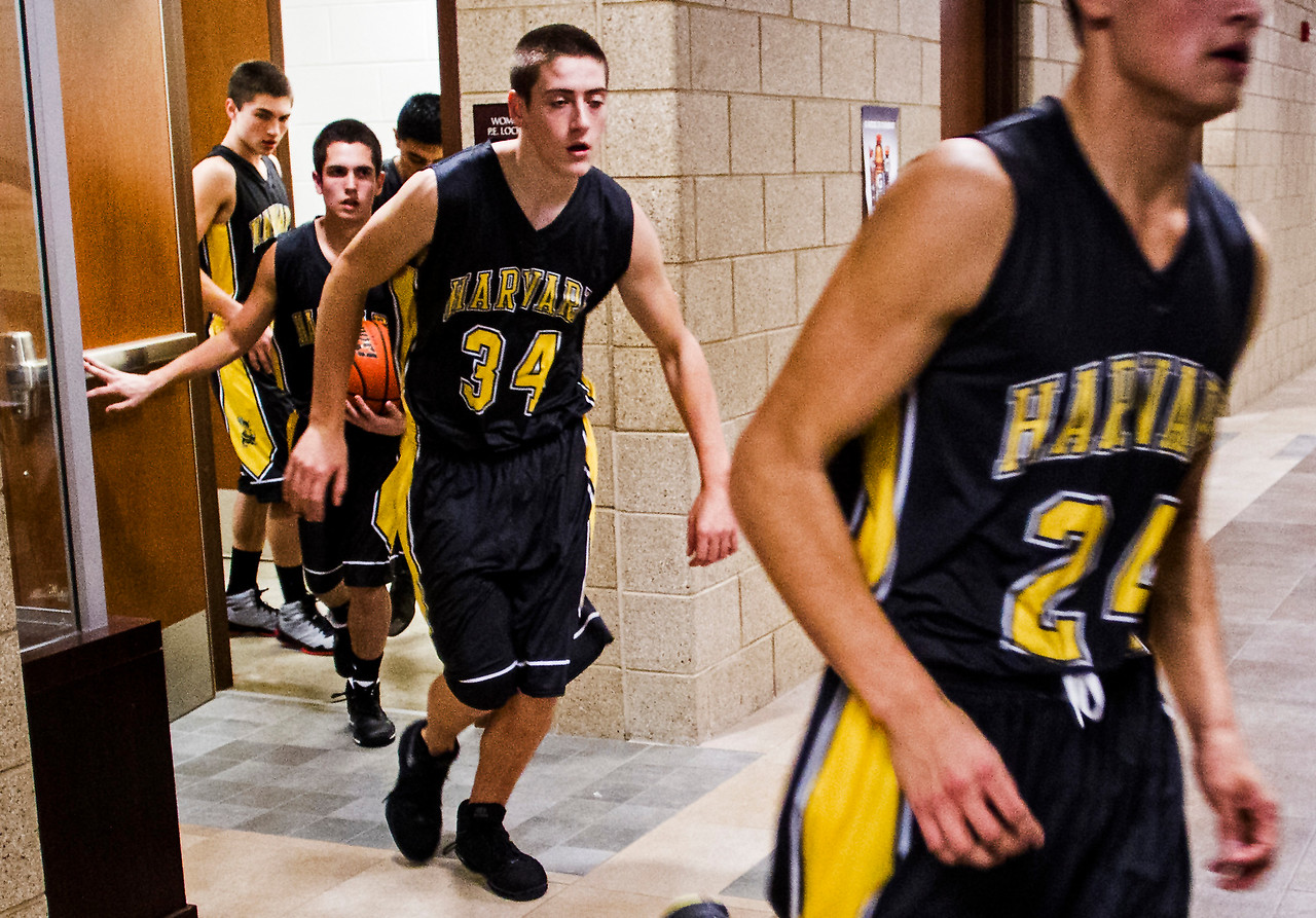 Kyle Grillot - kgrillot@shawmedia.com   The Harvard team exits the locker room before the start of the high school basketball game between Woodstock North and Harvard Wednesday in Woodstock. Woodstock North won the game 61-48.