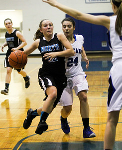 Sarah Nader- snader@shawmedia.com Woodstock North's Jenifer Crain (left) is guarded by Woodstock's Selena Juarez while she brings the ball down court during the second quarter of Thursday's game in Woodstock December 5, 2013. Woodstock won, 52-58.