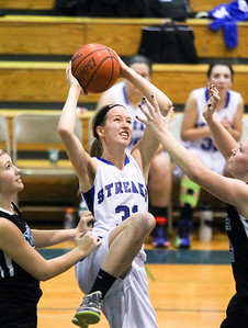 Sarah Nader- snader@shawmedia.com Woodstock's Cody Brand shoots during the third quarter of Thursday's against Woodstock North in Woodstock December 5, 2013. Woodstock won, 52-58.