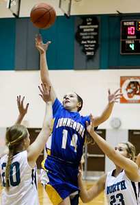 Sarah Nader- snader@shawmedia.com Johnsburg's Kayla Toussaint (center) shoots during the first quarter of Friday's game against Woodstock North in Woodstock December 6, 2013. Johsnburg won, 43-38.