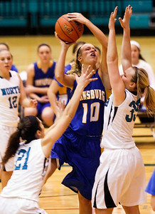 Sarah Nader- snader@shawmedia.com Johnsburg's Trace Chase shoots over Woodstock North's Haley Ahr during the third quarter of Friday's game in Woodstock December 6, 2013. Johsnburg won, 43-38.